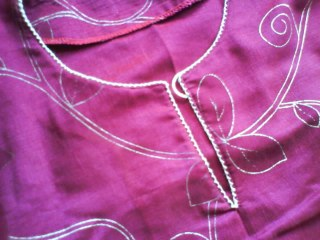 Baju kurung with Mata Lalat (collar decoration)